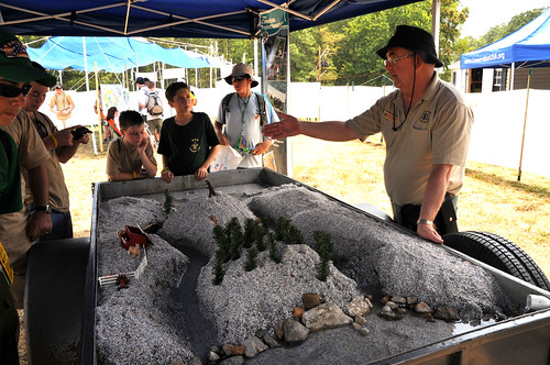Denny Mattison, US Forest Service, tells scouts how water from sudden rains can damage ecosystems (USDA Forest Service photo by Jerry Snyder.