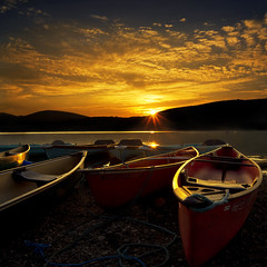 Until Tomorrow (adrians_art) Tags: sunset sky cloud mountains water boats lakedistrict canoes cumbria sunburst ullswater colorphotoaward