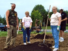 Chris Danbach poses with gardeners & compost