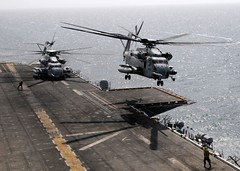 A Marine Corps CH-53E Sea Stallian Launches from the Flight Deck Aboard USS Peleliu (LHA 5)