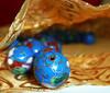 Calulate the wage (harp92) Tags: new blue red macro ball bag gold beads amazing nice awesome balls bead ramadan tabletop allah 2010 crative flickraward almalki new2010 harp92