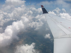 Over The Clouds (James B Currie) Tags: travel sky clouds plane airplane flying flight wing july airline 2010 usairways