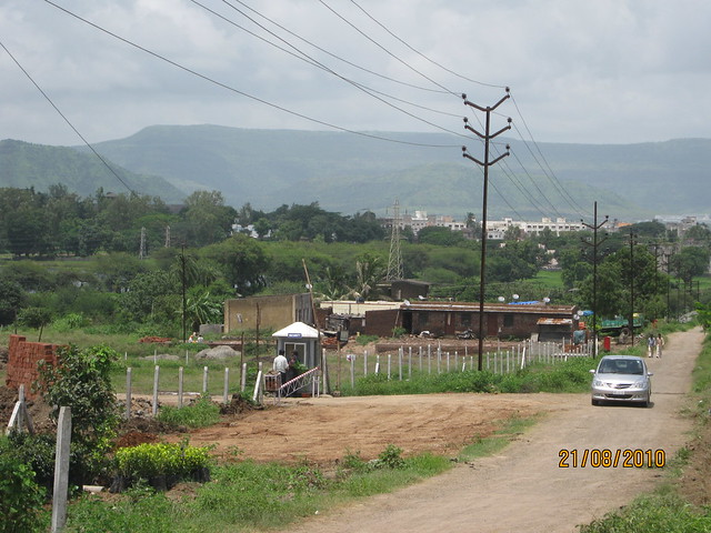 60' DP Road and main entrance of Naiknavare Lakeshore Residency, at Talegaon, on Old Mumbai Pune Highway (NH4)