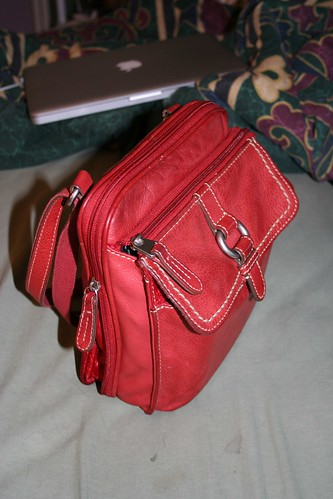 Photograph of my red purse, full and zipped up