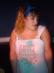 """Mystie Chamberlin working the merch table for Marah @ Madison Square Gardeners / Marah show 08.20.10 (wearing altered / autographed  """"Rhett Miller and the Serial Lady Killers"""" shirt purchased 08.19.10 @ City Winery - 155 Varick St., NYC) @ Bowery Electric (Just Another Folk Singer) Tags: show nyc newyorkcity silhouette shirt stars table august autograph bowery merch headband 2010 marah rhettmiller varick madisonsquaregardeners boweryelectric citywinery serialladykillers mystiechamberlin jamieeng"""
