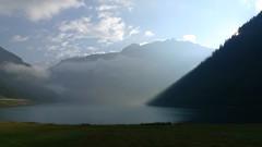 Lago di Livigno 1 (Alberto Cameroni) Tags: montagne lago nuvole agosto aurora 24 24mm nebbia 169 riflessi montagna lombardia paesaggio livigno riflesso mattina parconazionaledellostelvio lagodilivigno dlux4