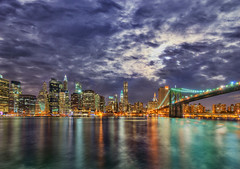 Manhattan Over the East River (Mister Joe) Tags: city nyc newyorkcity bridge urban panorama newyork brooklyn night clouds buildings reflections nikon cityscape skyscrapers manhattan joe brooklynbridge hudsonriver hdr manhattanatnight nighthdr