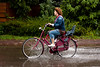 Waterfietsen (MasterWillems) Tags: road blue red green water rain yellow kids cycling jumping fload splashes carspeople floaded