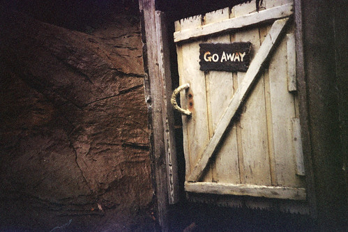 door with a sign that says go away