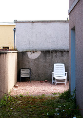 Space to Breathe. (e_alnak) Tags: street city uk greatbritain urban building lines architecture canon lost scotland moss weeds chair europe alone deckchair unitedkingdom britain angles sigma doorway negativespace aberdeen lonely documentarystyle alienation emptyspace ealnak imprisoningreality