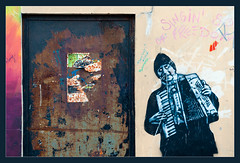 Poor Quality Door (Armando Fusco) Tags: door graffiti belfast rights nireland poorquality accordianplayer nikkor50mmf18d nikond300 rhyminsimon fallsrooad