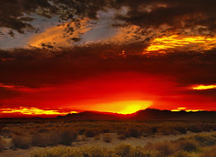 Crescent Sun (jimhankey) Tags: winter sunset red arizona sky cloud sun mountain storm mountains phoenix beautiful weather yellow clouds landscape desert cloudy dusk scenic naturallight sunny valley vista glowing redsky dramaticsky beautifulclouds beautifulview desertview stormclouds 2010 phoenixarizona arizonawinter beautifulscenery afternoonlight phoenixaz scenicview desertmountain maricopacounty yellowsky goldsky goldenafternoon unusuallight chandlerarizona chandleraz glowingcloud dearflickrfriend jimhankey arizonaweather nikond300 phoenixweather phoenixariz chandlerariz