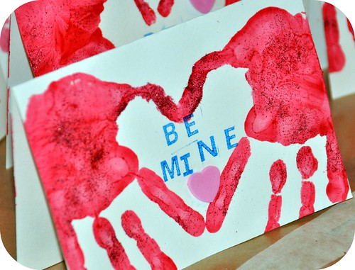 use hand prints to make this great valentines day heart card craft create a heart with the hands and put a valentines day message to create this unique - Valentine Day Crafts For Kids