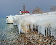 """Icicle  Beach""  Point Betsie Lighthouse, Crystallia, Michigan (Michigan Nut) Tags: trees usa snow cold reflection ice beach water geotagged frozen rocks stones wideangle pebbles icicles michiganlighthouses pointbetsielighthouse nikon1635mmf4gedafsvrwideanglezoomlens"