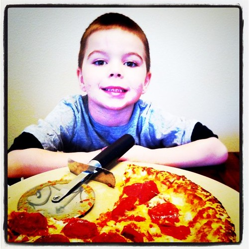 Angry Kid likes the #Freschetta pizza that I got free via @Blissdom. So good cooked on baking stone.