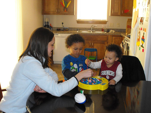 Katie Bowens and children active at play in their new  USDA-financed home.