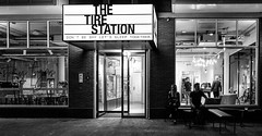The Tire Station (Island Way Photography) Tags: the tyre station amsterdam nl netherlands blackandwhite noiretblanc hotel people night lights sign street