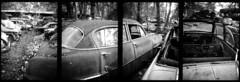 200708_03_29 (ShutterJam.co.cc) Tags: blackandwhite bw blackwhite rusty scrapyard wreck carcemetery cargraveyard autofriedhof grbetal kaufdorf messerli ricohcaddy