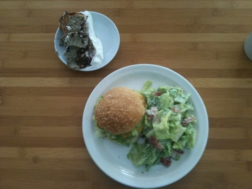 Spicy chicken burger, Caesar salad, lemon, chocolate and blueberry salad