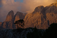 Sunset at Sella Group, Dolomites, Italy (Xindaan) Tags: italien blue light sunset red summer italy orange cloud mountain mountains tree nature berg silhouette rock clouds landscape geotagged evening abend licht nikon scenery europa europe italia sonnenuntergang cloudy dusk sommer natur himmel wolke wolken sigma berge blau f56 landschaft stein 70200 baum sella dolomites dolomiti d3 alpenglow 2010 gebirge dolomite dolomit 70200mm wolkig telezoom dolomiten gestein alpenglhen langkofel stonecity 7020028 sigma70200f28exdghsm zinne sassolungo campitellodifassa sellagroup trentinoaltoadige cittadeisassi 130mm sellagruppe steinernestadt d3s saslonch zitadeisasc