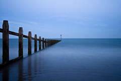 Groyne & Sea at Night (ChrisDale) Tags: longexposure blue sunset sea beach canon evening coast wideangle minimal devon groyne 1022mm dawlish dawlishwarren 400d