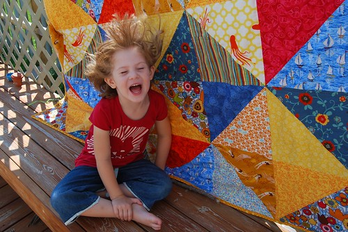 Girl and Quilt--did I mention windy?