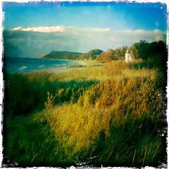 picture perfect at empire beach (farlane) Tags: lighthouse beach grass michigan empire sleepingbeardunes beachgrass leelanau