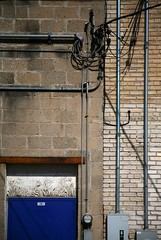 intersections (Studiobaker) Tags: door blue brick minnesota vertical horizontal silver concrete wire alley october minneapolis utility neighborhood doorway mpls wires ave area service block meter avenue electrical 2008 mn meters utilities conduit connect connections lyndale lynlake studiobaker