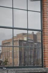 Warehouse reflections (Pim Stouten) Tags: holland reflection brick netherlands cookies architecture industrial factory chocolate warehouse zaandam pakhuis weerspiegeling verkade erfgoed koekfabriek