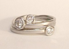 Three stone ribbons style ring
