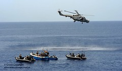 Lynx Helicopter Hovers Over Suspected Pirates (Defence Images) Tags: uk pirates aircraft military free equipment helicopter piracy british defense defence boarding lynx osprey aden royalnavy fre royalmarines skiffs gulfofaden seaboats mk8 hmsportland mark8 ctf151 counterpiracy fleetsea08 combinedtaskforce
