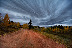 Tempestuous Messenger (Fort Photo) Tags: road autumn sky storm fall nature weather clouds skyscape landscape vanishingpoint nikon colorado stormy co aspen hdr cloudscape teller 2010 striated striations nikon1735 d700 pathscaminhos astmospheric