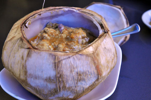Steamed Seafood Curry in Coconut Shell.