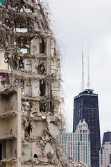 A contrast of styles (The New No. 2) Tags: city urban building green tower home buildings project gbrearview destruction demolition housing cha clearing 2010 wrecking housingproject cabrinigreen chicagoist cabrini johncrouch johncrouchphotography crouchphotos williamgreenhomes