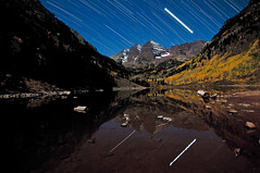 Jupiter Bells (Mike Berenson - Colorado Captures) Tags: trees sky lake reflection fall nature water leaves yellow night bells stars nikon colorado seasons planet jupiter aspen allrightsreserved startrails maroonbells d300 maroonlake wildernessarea northmaroonpeak southmaroonpeak coloradocaptures copyright2010bymikeberenson startrailstacking