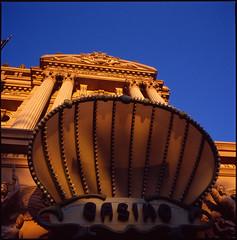 Casino (Bright Lights, Vegas Nights) Tags: blue sky paris warm lasvegas casino lookup hasselblad goldenlight lasvegasstrip hasselblad500cm parishotelcasino autaut carlzeissdistagon50mmf40 sekonicl308s