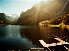 Golden reflection  (Gosausee..:)) (Katarina 2353) Tags: wood travel blue autumn trees light sunset vacation sky mist mountain lake snow alps reflection green film nature water berg grass fog alpes sunrise landscape geotagged photography austria golden see boat
