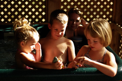 Kids playing in the hot tub