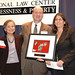 Maria, Ed and Suzanne Turner display Dechert Pro Bono Counsel Award