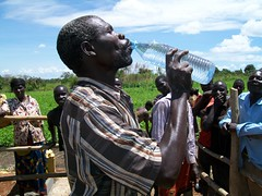 A man takes the first sips of clean water