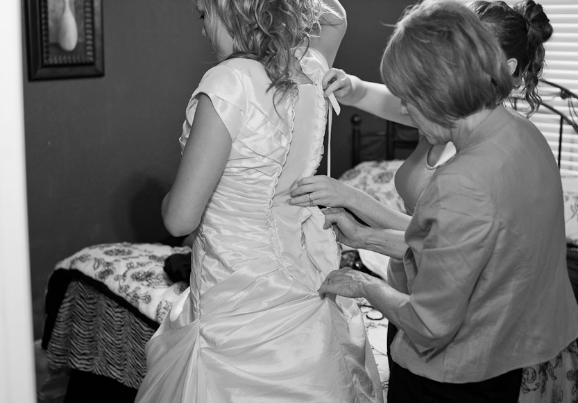 B&W  Buttoning of the Brides Dress