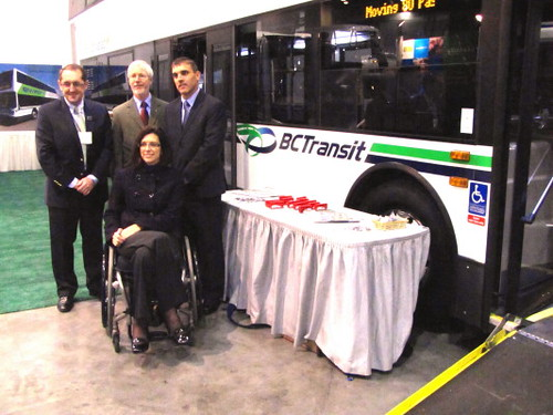 The Honorable Stephanie Cadieux, Minister of Community, Sport and Cultural Development, Province of BC (on wheelchair) with others at Trans-Expo 2010 Shows Hybrid Diesel-Electric, GPS, Wi-Fi, Solar-Power & H.264 Technologies in Public Transit Buses