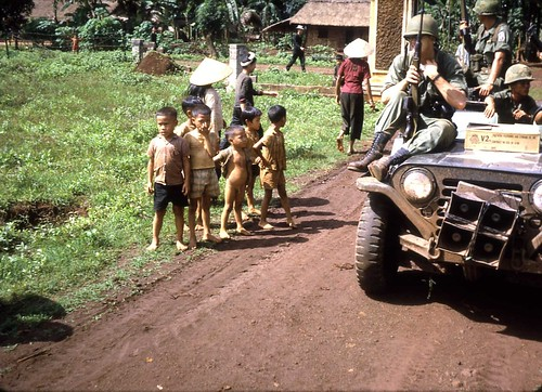 Medics from the 173rd Airborne on a MedCap Mission near Bien Hoa, Vietnam 1966 by Dr James Hughes by 7th Surgical Hospital (MA)  Vietnam