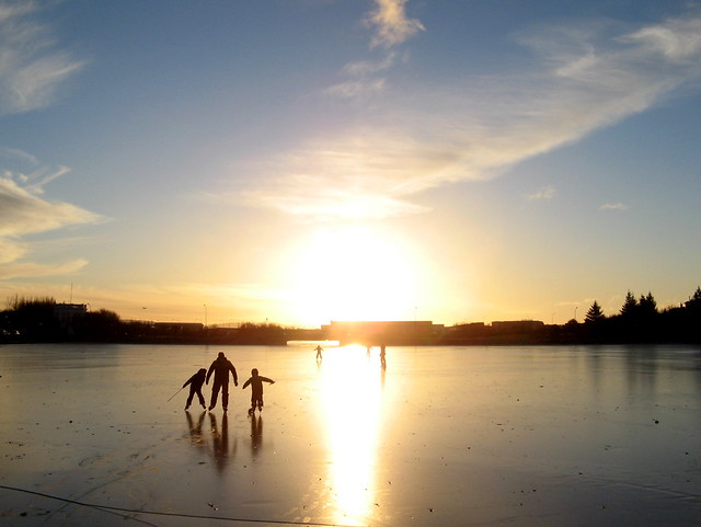 Skating on frozen Tjornin, Reykjavik