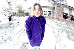 Little purple coat (Pointless Pamela) Tags: distortion cold cute girl smiling canon outside happy purple little coat adorable messyhair chilly bigbrowneyes fisheyelens revelxs