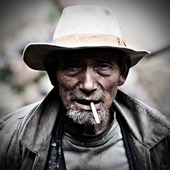 Old Smoker (Jonathan Kos-Read) Tags: china portrait asian cool asia chinese oldman smoking tibetan  yunnan wrinkles veryold  500x500 chinesecinema  asiancinema chinesefilm asianfilm asianeyes chinesetv  asiantv chineseeyes oldasianman  verywrinkled zangpao asianshowbusiness chineseshowbusiness