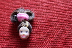Doll head (F4C Design) Tags: texture doll head redbackground fabricmacrocanont2iredbackground