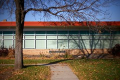 ominous shadow (Studiobaker) Tags: blue school autumn windows shadow red building tree green fall leaves minnesota wall canon silver 50mm scary branch shadows exterior ominous f14 haunted spooky sidewalk trunk limb mn haunt shadowy lakeville various3 studiobaker