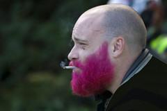 Red (or is it Pink?) bearded biker (Frank Fullard) Tags: street charity portrait beard candid smoke failure disaster biker dye smoker fas fullard frankfullard