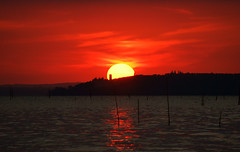 Sphere (Massimo Valiani) Tags: sunset red orange cloud lake black tower water island fire crystal sony sphere perugia umbria massimo trasimeno reflexes polvese torricella a350 valiani